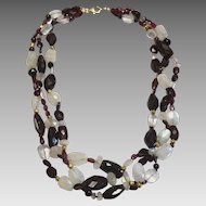 Multi Strand Garnet, Rainbow moonstone 18 karat Gold wax bead necklace