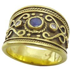 Vintage Handcrafted 18 karat Gold , Diamond and Sapphire Ring