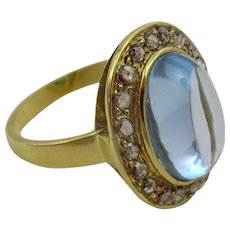 Handmade Aquamarine and rough cut Diamonds in 18 karat Gold.