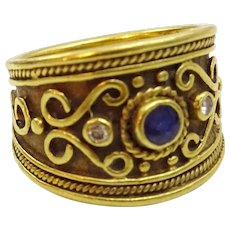 Vintage Handcrafted 18 karat Gold , Sapphire and Diamond Ring
