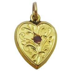 Vintage 18 karat Gold and Ruby Heart Pendant