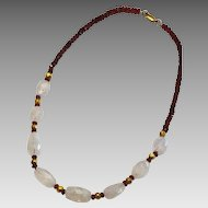 Garnet, Rainbow Moonstone and 18 k Gold Wax beads Necklace