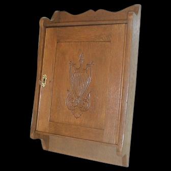 Oak Medicine Cabinet with Carved Door
