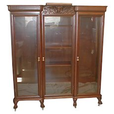 Mahogany Three Door Bookcase with Carved Cupid Crest and Claw Feet Circa 1890