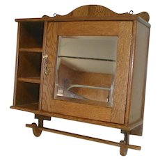 Oak Medicine Cabinet with Beveled Mirror and Side Cubbies Circa 1910
