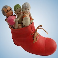Old woman in a shoe with children bisque porcelain dolls in original box excellent condition
