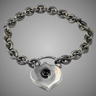 Gorgeous engraved and textured sterling silver bracelet with large over sized ornate padlock set with bohemian garnet