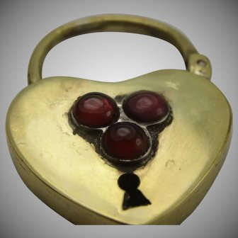 Gorgeous over sized padlock set with natural berry bohemian garnets, beautifully made
