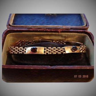 Beautiful pinch beck and garnet bracelet presented in its own original antique box