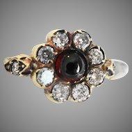 Antique diamond and garnet daisy ring
