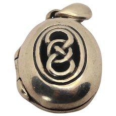 Antique Sterling silver puffy love knot locket