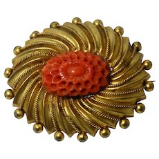 A gorgeous pinchbeck and natural carved coral Victorian brooch