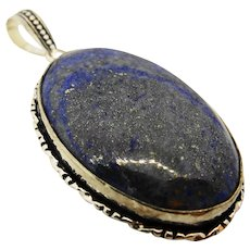 A gorgeous large vintage lapiz lazuli and sterling silver pendant