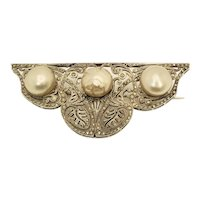 A stunning Art Deco marcasite silver and mabe pearl brooch