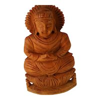 antique Indonesian light wood carved Buddha