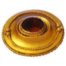 A stunning Victorian Estrucan garnet brooch