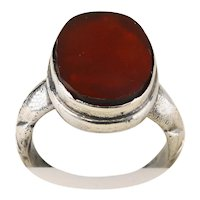 A gorgeous antique silver and carnelian poison ring
