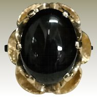 Black Onyx set in a 14k yellow gold butter cup style finger ring. Mid century, 1950's