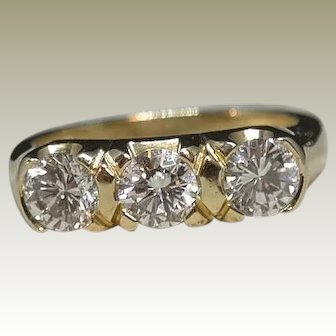 Handmade 14k Yellow Gold Three Stone Diamond Ring with a total weight of 1.50 ct-tw.
