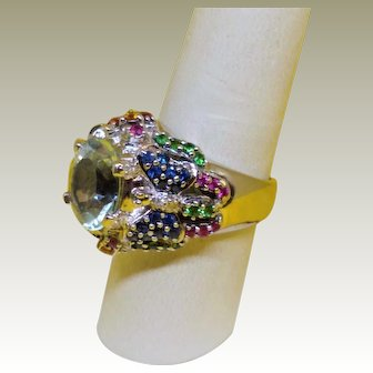 Vintage 14K White Gold Aquamarine accented with rubies, emeralds, sapphires, citrines and diamonds in a butterfly design.