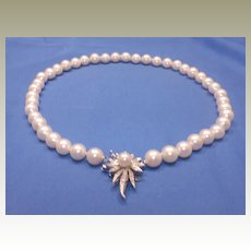 Vintage, cultured pearl necklace with 14 karat white gold diamond set catch