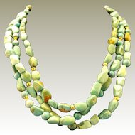 Three Strand Turquoise Beads Necklace with 14k gold catch and beads.