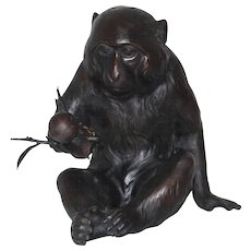 Japanese Taisho Period Seated Bronze Monkey Holding a Persimmon Branch by Shuzan
