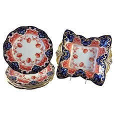 Aynsley Gilt Dessert Group Six Plates and Cake Dish Imari Colors