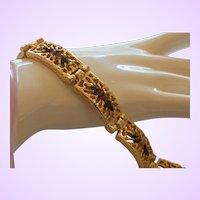 Signed SHP Heavy Gold Tone Bracelet with Topaz Rhinestones