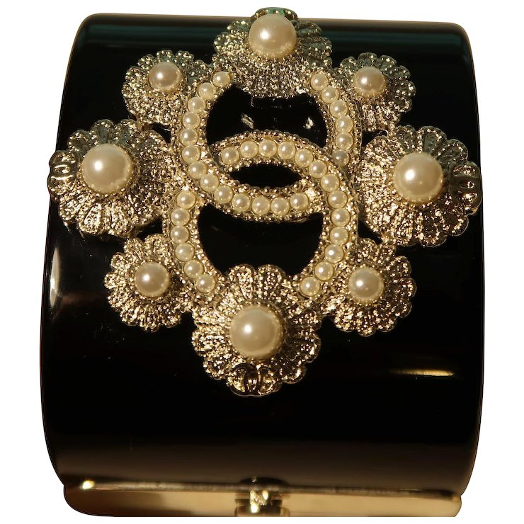 Chanel Black Resin Cuff Bracelet With Double C Logo And Faux Pearls