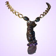 Signed Iradj Moini Necklace with Semi-Precious Stones and a Signed Hand Carved Figural from Resin