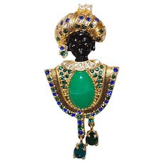 Signed Locof oco  Blackamoor Brooch With Blue and Green Rhinestones