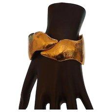 Signed YSL Bracelet in Gold Tone Metal