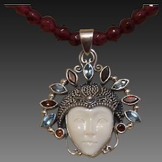 Hand Strung Red Garnets with  Moon Goddess Pendant