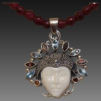 Hand Strung Red Garnets with  Moon Goddess Pendant