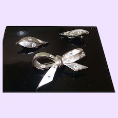 Signed BSK Brooch Set in Silver Tone Metal with Rhinestones