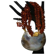 Triple Strand of Baltic Amber with Large Shell