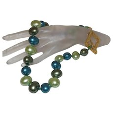 Cultured Mabe' Pearl Necklace With Natural Green Emeralds and 14KYGF Clasp