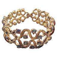 Coro Goldtone Curlique Bracelet with Blue AB Rhinestones