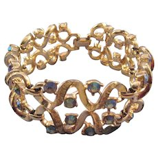 Coro Goldtone Curlique Bracelet with Blue AB Rhinestones