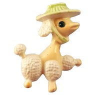 Enameled Poodle Dog Pin - Wearing A White Basket Hat