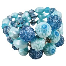 Vintage Triple Strand Memory Wire Bracelet with Plastic Specialty - Molded Baby Blue Beads