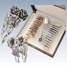 Twelve German .835 Silver Coffee Spoons with Rose pattern