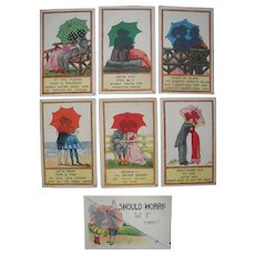 Lot 7 c1910s Artist Signed  Postcards Silhouettes in Umbrella