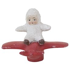 RARE 1930s German Bisque Snow Baby on a Red Airplane