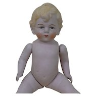 Seven Inch Jointed All Bisque German Doll Stationary Head and Molded Hair