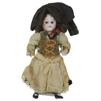 4 inch original dress German All Bisque doll glass eyes 3rd of 4