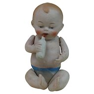 1910's-1920's All Bisque Baby with Bottle