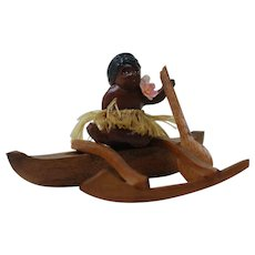 1930's Porcelain Hawaiian Figure with Wood Boat and Paddle