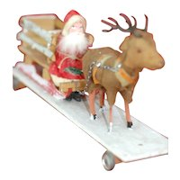 Early German Santa Sleigh and Reindeer on platform wheeled pull toy